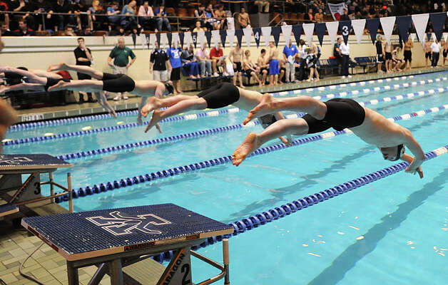 At right, Dan Williams of Staples competes in the 500 freestyle event during the State Open swimming championships at Yale University, New Haven, Conn., Saturday, March 16, 2013. Photo: Bob Luckey / Greenwich Time