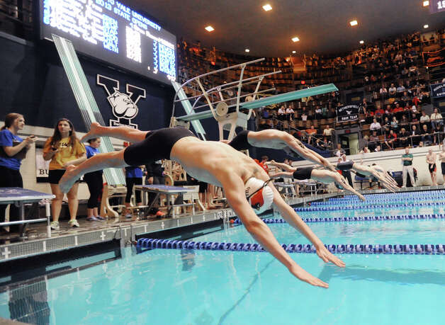 At left, Thomas Dillinger of Greenwich competes in the 500 yard freestyle event during the State Open swimming championships at Yale University, New Haven, Conn., Saturday, March 16, 2013. Photo: Bob Luckey / Greenwich Time