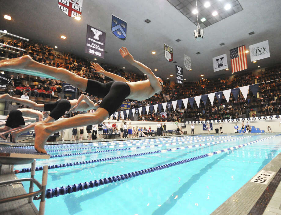 At right, Brandon Cole of Fairfield Prep competes in the 500 yard freestyle event during the State Open swimming championships at Yale University, New Haven, Conn., Saturday, March 16, 2013. Photo: Bob Luckey / Greenwich Time