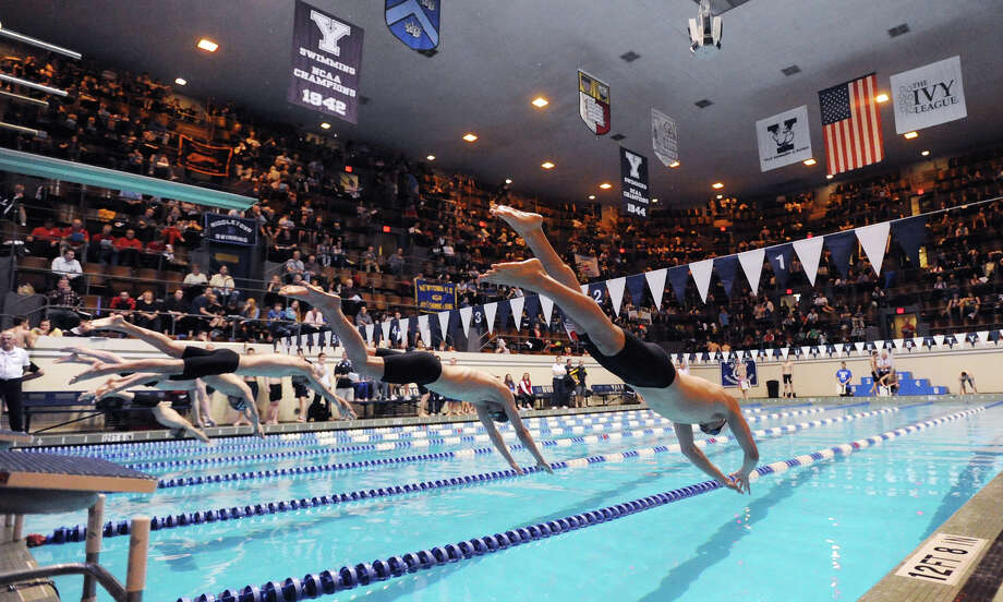 At right, Brando Cole of Fairfield Prep competes in the 500 freestyle event during the State Open swimming championships at Yale University, New Haven, Conn., Saturday, March 16, 2013. Photo: Bob Luckey / Greenwich Time