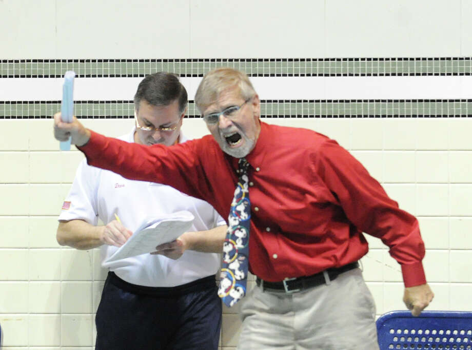 Greenwich High School swimming coach Terry Lowe, red shirt, reacts in the final minutes of swim meet in which his team won the State Open swimming championship at Yale University in New Haven, Conn., Saturday, March 16, 2013. Photo: Bob Luckey / Greenwich Time