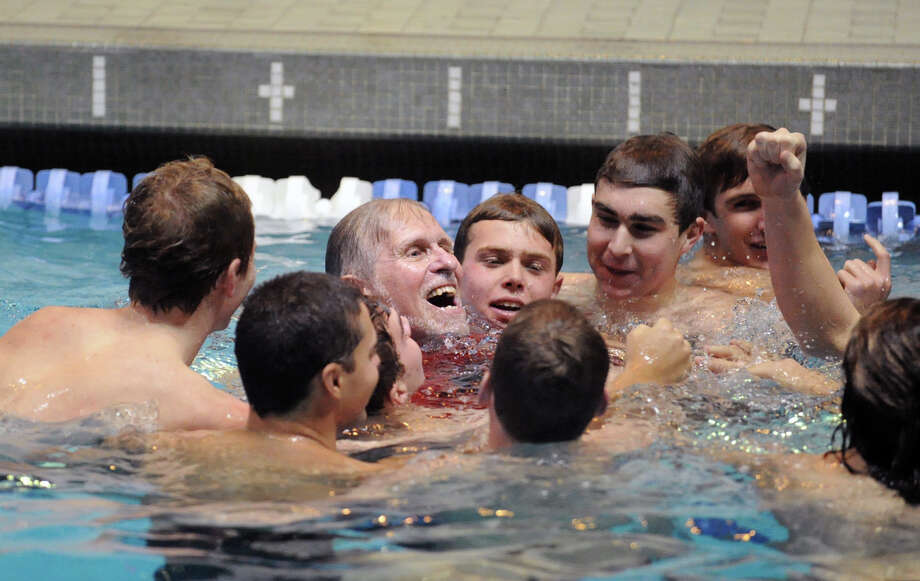 Greenwich High School swimming coach Terry Lowe, third from left, reacts after getting thrown into the Yale University swimming pool after his team won the State Open swimming championships at Yale in New Haven, Conn., Saturday, March 16, 2013. Photo: Bob Luckey / Greenwich Time