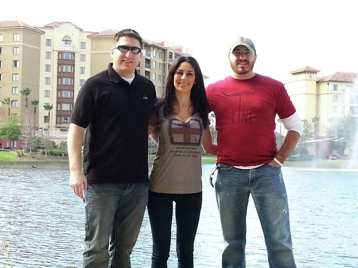 Daniel Merritt, left, and his brother Tyler Merritt pose with Jessica Klein wearing 9 Line Foundation clothing. The two Stamford brothers have started a clothing line and foundation to help wounded veterans like Jessica's husband Edward