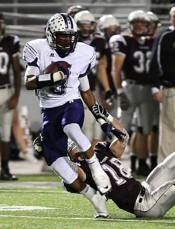 Newton running back Kevin Shorter, #3, is taken down by Cameron Yoe's Zach Riola, #18, during the Newton High School Class 2A Division I state semifinal game against Cameron Yoe at the Woodforest Bank Stadium in Shenandoah, TX on December, 14, 2012. Photo taken: Randy Edwards/The Enterprise Photo: Randy Edwards