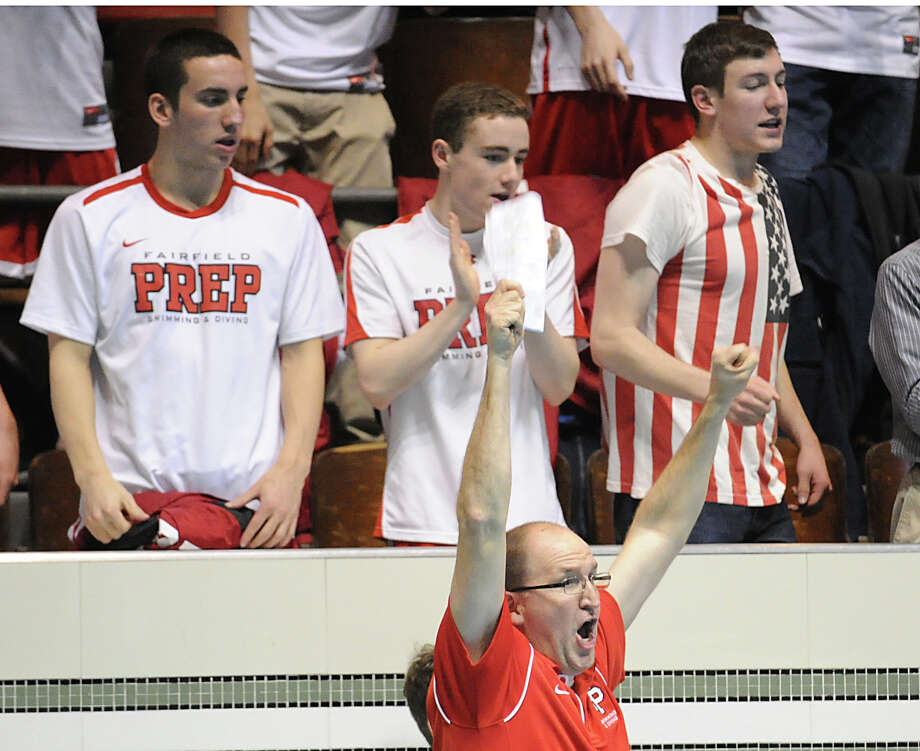 Fairfield Prep coach Rick Hutchinson reacts during the State Open swimming championships at Yale University, New Haven, Conn., Saturday, March 16, 2013. Photo: Bob Luckey / Greenwich Time