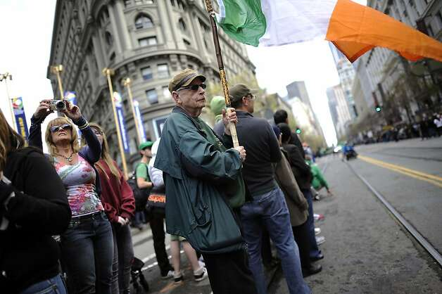 Steve O'Connor of San Francisco has attended 20 parades and even brought his own flag, at the annual St. Patrick's Day Parade in San Francisco, Saturday March 16th, 2013. Photo: Michael Short, Special To The Chronicle