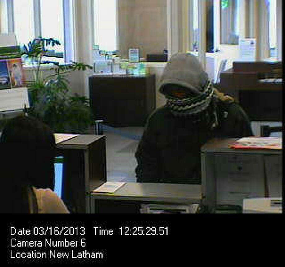 Colonie police released this surveillance photo in connection with their investigation of a bank heist at the Pioneer Savings Bank on Route 7. (Colonie Police photo)