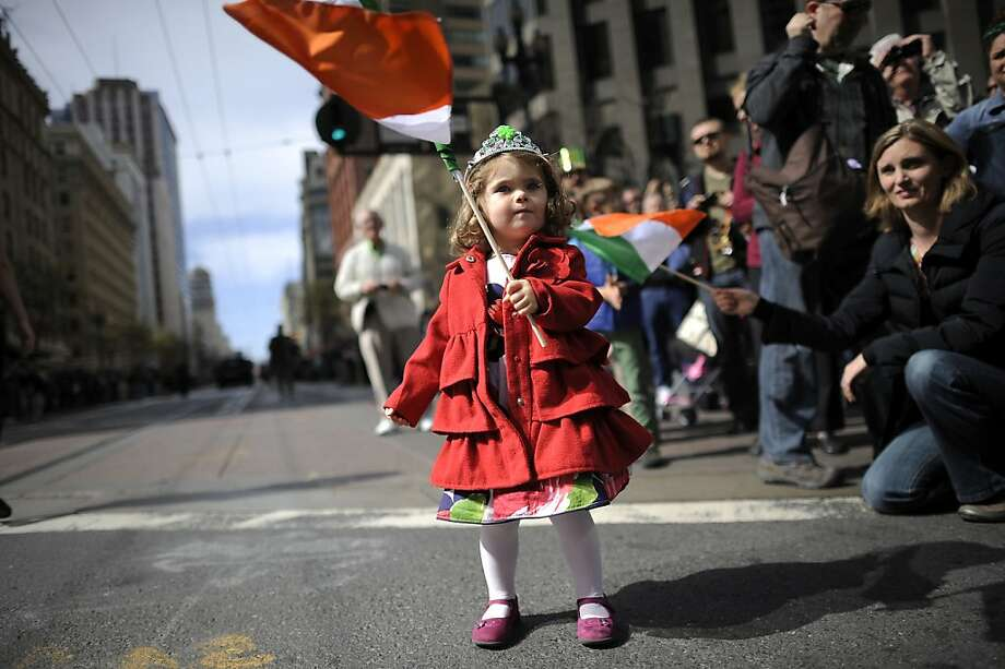 Seraphina O'Sullivan, 2, of San Franicsco, waves an Irish flag as she watches the annual St. Patrick's Day Parade in San Francisco, Saturday March 16th, 2013. Photo: Michael Short, Special To The Chronicle