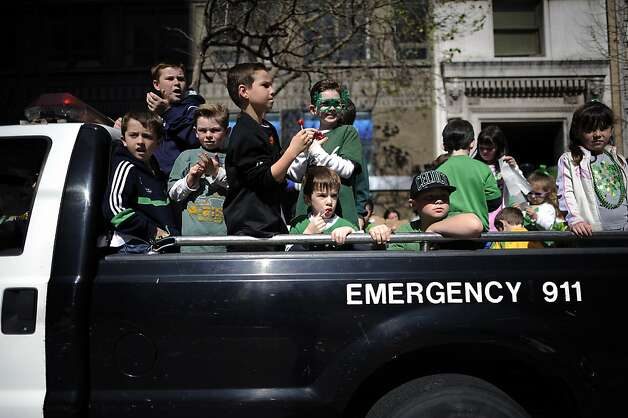 Children of police officers are seen in the back of a police truck that will be joining the annual St. Patrick's Day Parade in San Francisco, Saturday March 16th, 2013. Photo: Michael Short, Special To The Chronicle