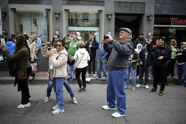 Thousands of people line Market St. to watch the annual St. Patrick's Day Parade in San Francisco, Saturday March 16th, 2013. Photo: Michael Short, Special To The Chronicle
