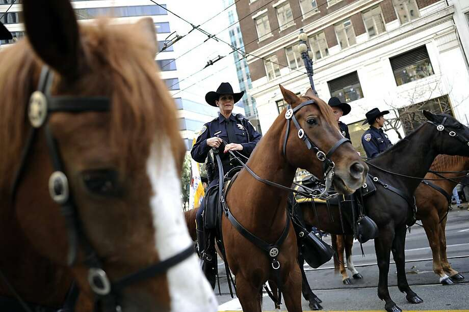 SFPD Officer Susan Rolovich is seen astride her horse Deuce at the start of the annual St. Patrick's Day Parade in San Francisco, Saturday March 16th, 2013. Photo: Michael Short, Special To The Chronicle