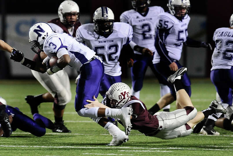 Newton running back Kevin Shorter, #3, is taken down by a Cameron Yoe defensive player during the Ne