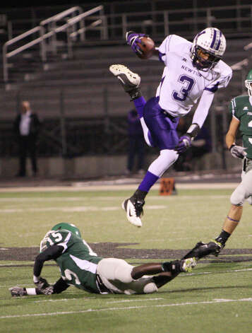 Newton running back Kevin Shorter, No. 3, leaps over a defender during the Class 2A Division I state quarterfinals against Franklin  Friday at Abe Martin Stadium in Lufkin. (Matt Billiot/Special to the Enterprise)