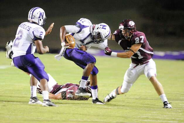 Silsbee defensive back Garrett Drake (27) finds a way to bring down Newton running back Kevin Shorter (11) in the first half of their game at Silsbee High School on Friday, September 16, 2011. Valentino Mauricio/The Enterprise Photo: Valentino Mauricio