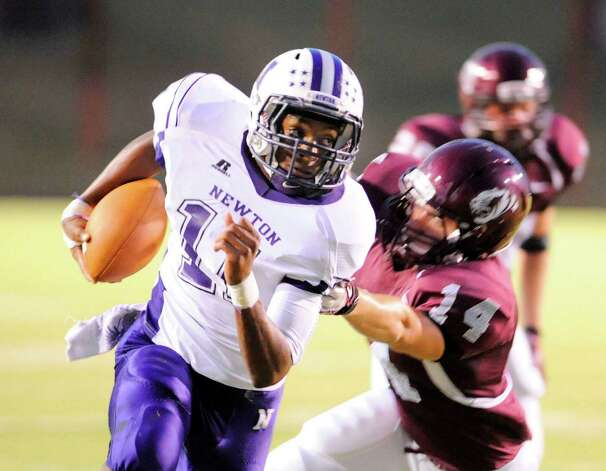Newton running back Kevin Shorter (11) tries to evade the grasp of Silsbee defender Jacob Keefer (14) in the first half of their game at Silsbee High School on Friday, September 16, 2011. Valentino Mauricio/The Enterprise Photo: Valentino Mauricio