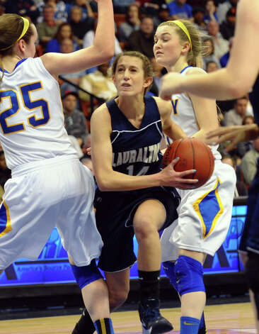 Lauralton Hall's #14 Michelle DeSantis tries to break through to the basket between two Mercy defenders, during Class LL girls basketball final action in Uncasville, Conn. on Saturday March 16, 2013. Photo: Christian Abraham / Connecticut Post