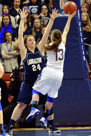 Lauralton Hall's #24 Emily Bonzagni looks to block a shot by Mercy's #13 Maria Weselyj, during Class LL girls basketball final action in Uncasville, Conn. on Saturday March 16, 2013. Photo: Christian Abraham / Connecticut Post