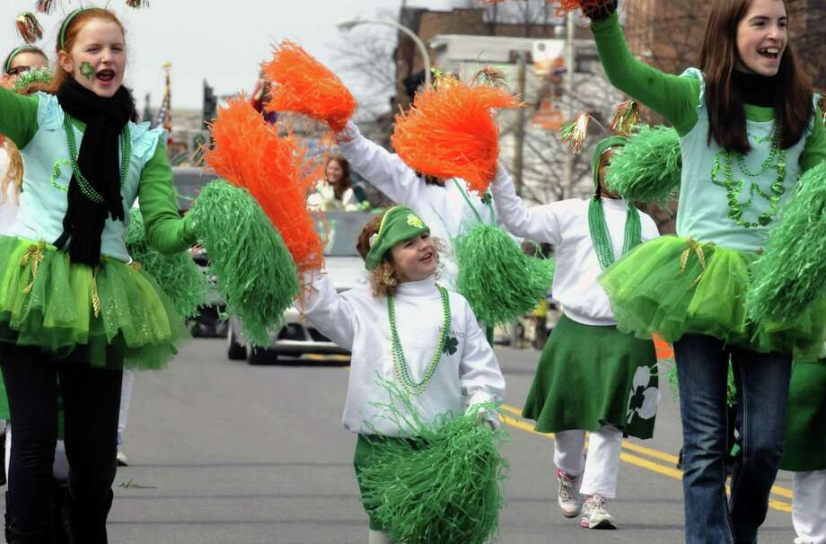 Allisin Masline, center, marches with the Menands Pom Poms during the Albany St. Patrick's Day Parade on Saturday March 16, 2013 in Albany, N.Y. (Michael P. Farrell/Times Union) Photo: Michael P. Farrell