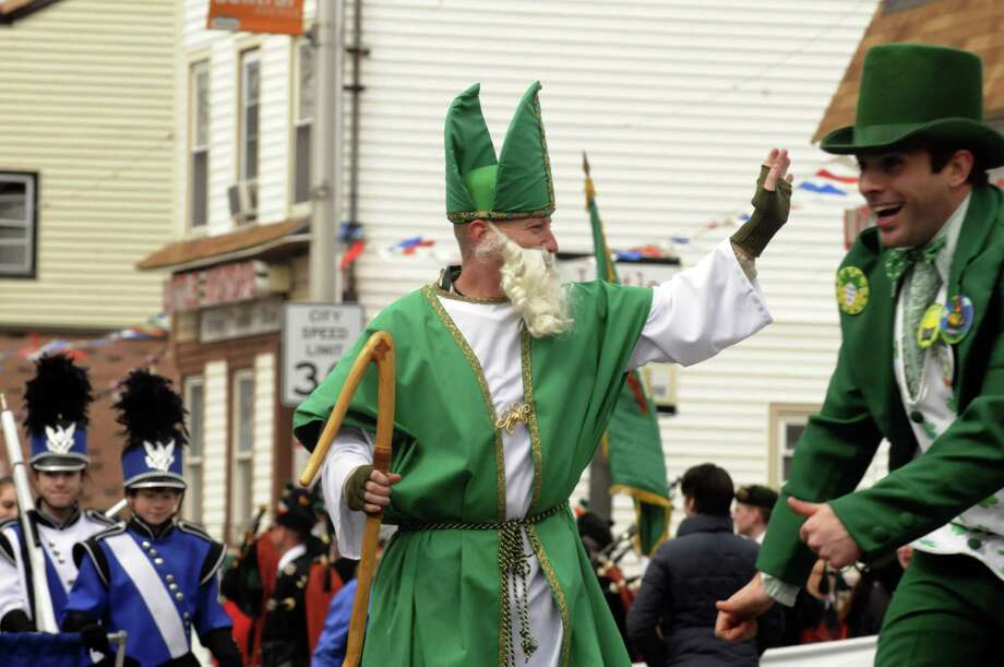 St. Patrick waves to the crowd during the Albany St. Patrick's Day Parade on Saturday March 16, 2013 in Albany, N.Y. (Michael P. Farrell/Times Union) Photo: Michael P. Farrell