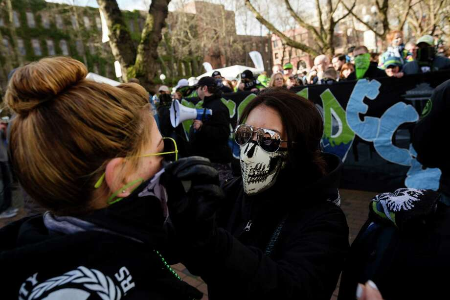 Seattle Sounders fans chant and wave flares in a show of friendly intimidation during the pre-game rally and march to stadium before a game against the Portland Timbers Saturday, March 16, 2013, at CenturyLink Field in Seattle. Photo: JORDAN STEAD / SEATTLEPI.COM
