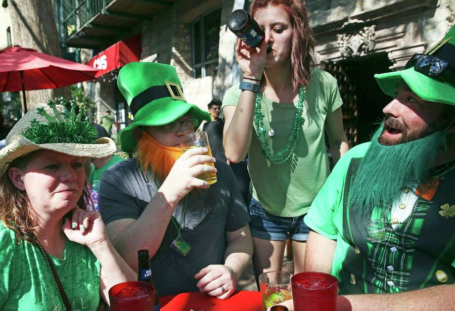Eric Stevenson and Elizabeth Jancewicz enjoy and ice cream cone by a green river as St. Patrick's Day is celebrated on the Riverwalk and La Villita  on  March 16, 2013. Photo: Tom Reel, San Antonio Express-News / 2017 SAN ANTONIO EXPRESS-NEWS