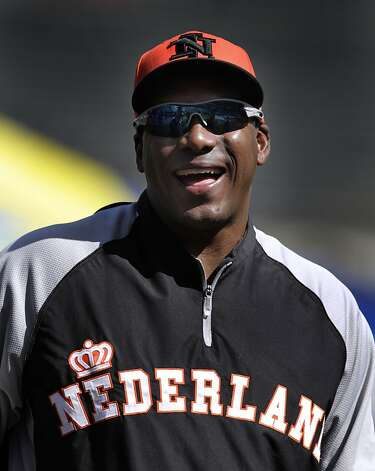 Netherlands manager and Giants hitting coach Hensley Meulens laughs during a team workout for the World Baseball Classic championship round at AT&T Park in San Francisco, Calif. on Saturday, March 16, 2013. Photo: Paul Chinn, The Chronicle