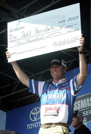 Todd Faircloth shows his big check of the day at the Bassmasters Elite Series fishing tournament weigh in in Orange on Saturday, March 16, 2013. Photo taken: Randy Edwards/The Enterprise Photo: Randy Edwards
