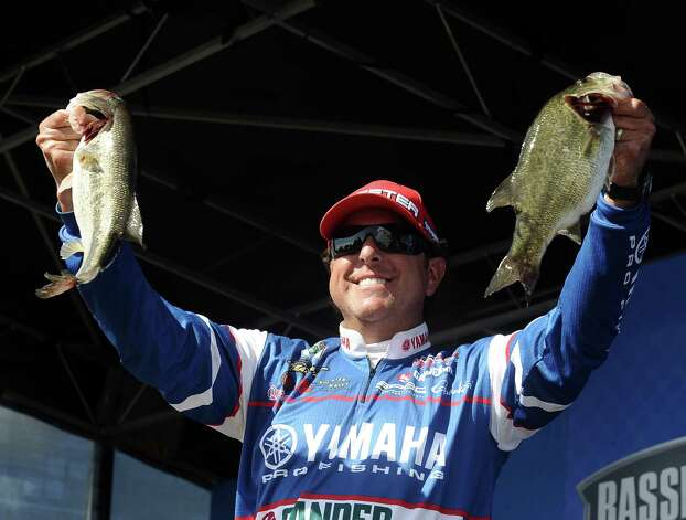 Dean Rojas shows his big catch of the day at the Bassmasters Elite Series fishing tournament weigh in in Orange on Saturday, March 16, 2013. Photo taken: Randy Edwards/The Enterprise Photo: Randy Edwards