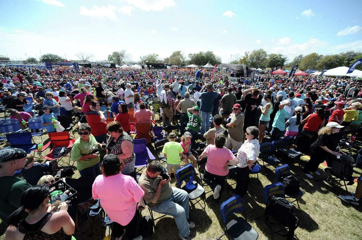 Fans get wild for the camera at the Bassmasters Elite Series fishing tournament in Orange on Saturday, March 16, 2013. Photo taken: Randy Edwards/The Enterprise