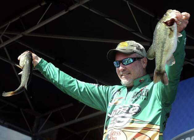 Dennis Tietje shows his big catch of the day at the Bassmasters Elite Series fishing tournament weigh in in Orange on Saturday, March 16, 2013. Photo taken: Randy Edwards/The Enterprise