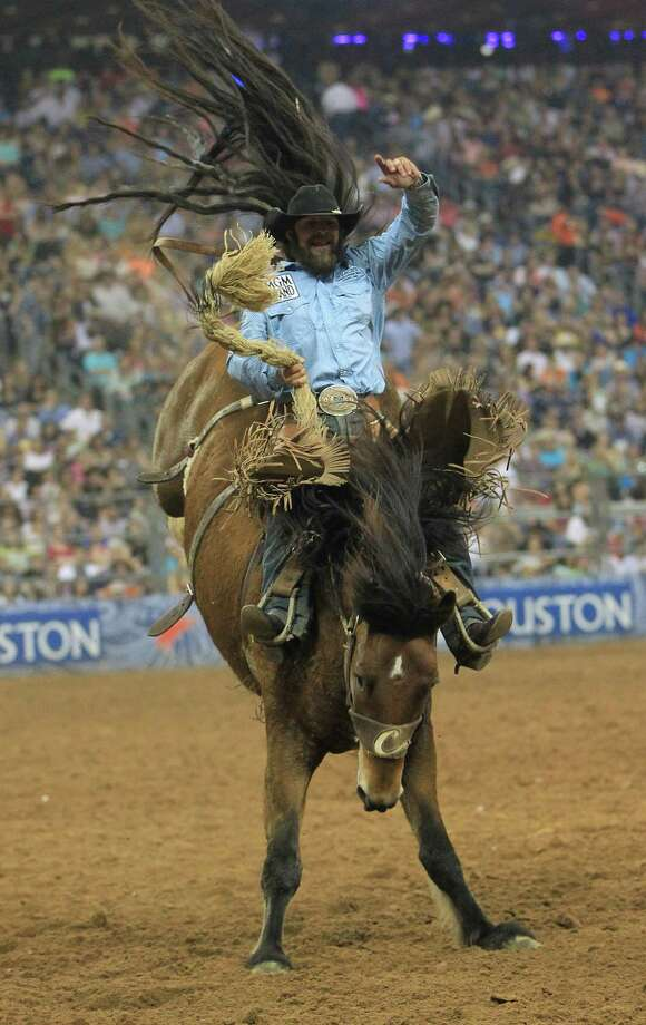 Wade Sundell during his championship Saddle Bronc Ride during the final BP Super Series Championship at the Houston Livestock Show and Rodeo Saturday, March 16, 2013, in Houston. Photo: Karen Warren, Houston Chronicle / © 2013 Houston Chronicle