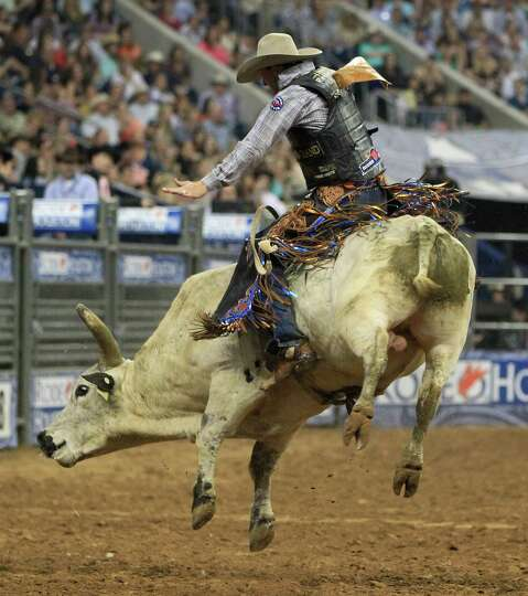 J.W. Harris during his championship Bull Ride during the final BP Super Series Championship at the H