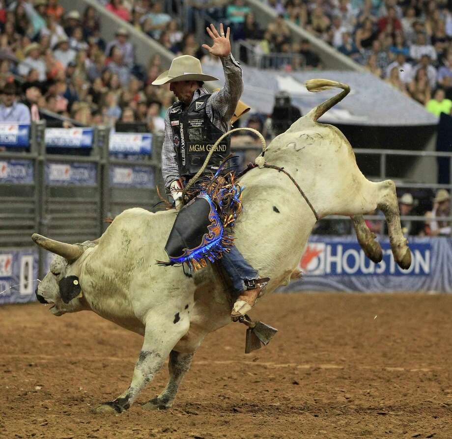 J.W. Harris during his championship Bull Ride during the final BP Super Series Championship at the Houston Livestock Show and Rodeo Saturday, March 16, 2013, in Houston. Photo: Karen Warren, Houston Chronicle / © 2013 Houston Chronicle