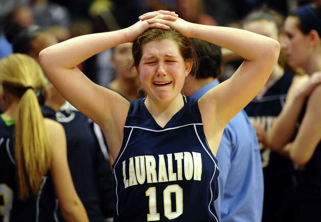 Lauralton Hall's #10 Carly Fabbri reacts after Mercy wins the Class LL girls basketball final at the Mohegan Sun Arena in Uncasville, Conn. on Saturday March 16, 2013. Photo: Christian Abraham / Connecticut Post