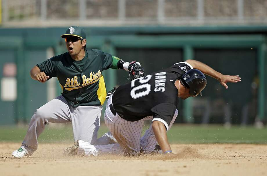 A's shortstop Hiro Nakajima tags out Chicago's Jordan Danks on an attempted steal in the fifth inning of an Oakland loss. Photo: Mark Duncan, Associated Press
