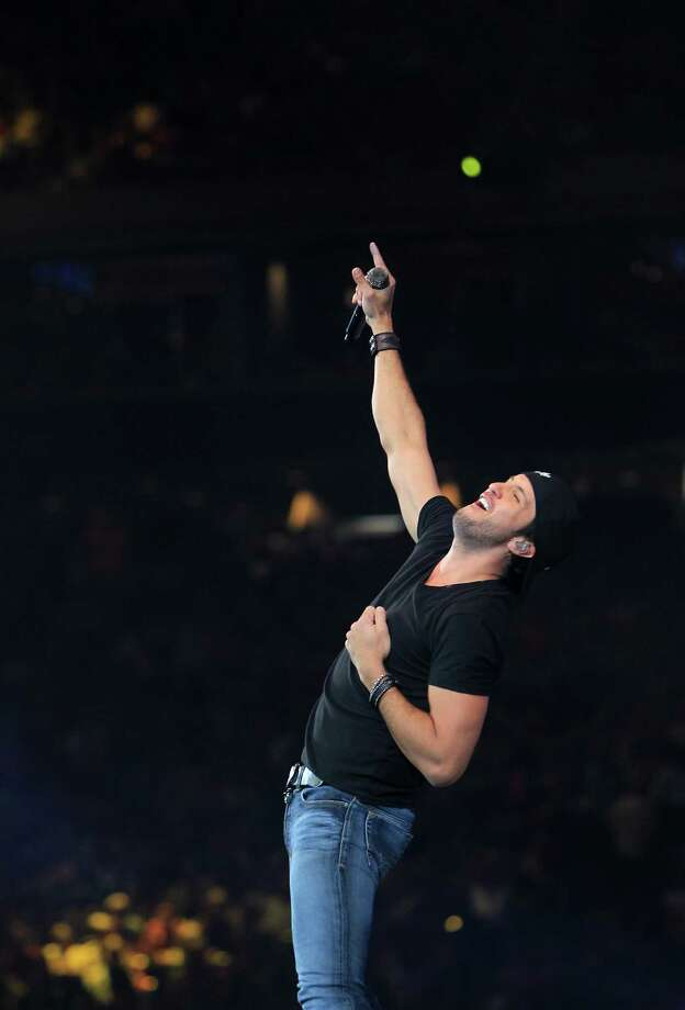 Luke Bryan performs at the Houston Livestock Show and Rodeo Saturday, March 16, 2013, in Houston. Photo: Karen Warren, Houston Chronicle / © 2013 Houston Chronicle