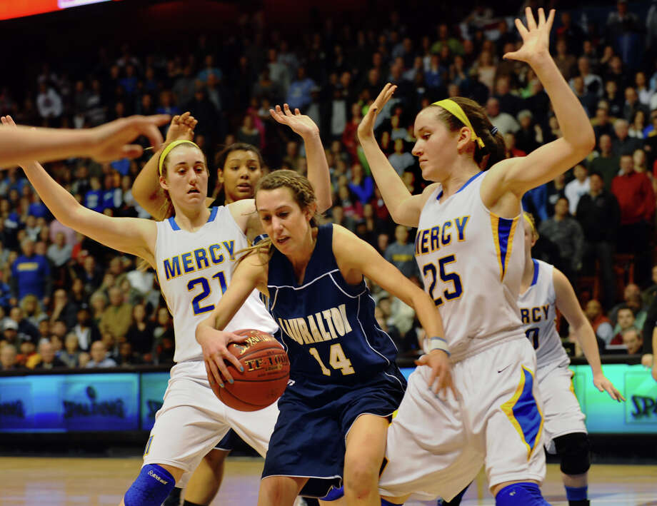 Lauralton Hall's #14 Michelle DeSantis gets stuck between Mercy's #21 Sheena Landy, left, and #25 Maura Ftzpatrick, during Class LL girls basketball final action at Mohegan Sun Arena in Uncasville, Conn. on Saturday March 16, 2013. Photo: Christian Abraham / Connecticut Post