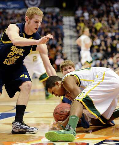 Neno Merritt, Trinity Catholic High School, fights for a loose ball in the CIAC class L boys basketball championship game against Woodstock Academy at Mohegan Sun Arena in Uncasville, Conn. on Saturday, March 16, 2013. Photo: Mark Conrad / Connecticut Post Freelance