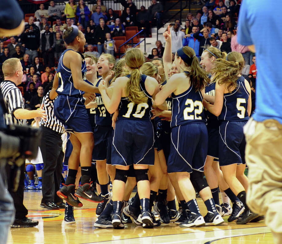 Lauralton Hall celebrates prematurely, during Class LL girls basketball final action against Mercy at Mohegan Sun Arena in Uncasville, Conn. on Saturday March 16, 2013. Officials did not hear the call for a time out in the final seconds. Over three seconds was actually left on the clock which gave Mercy the opportunity to send a shot into the basket for three points, beating Lauralton Hall 54-53. Photo: Christian Abraham / Connecticut Post