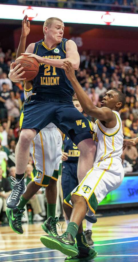 Sullivan Gardner, Woodstock Academy, pulls down a rebound in the CIAC class L boys basketball championship game against Trinity Catholic High School at Mohegan Sun Arena in Uncasville, Conn. on Saturday, March 16, 2013. Photo: Mark Conrad / Connecticut Post Freelance