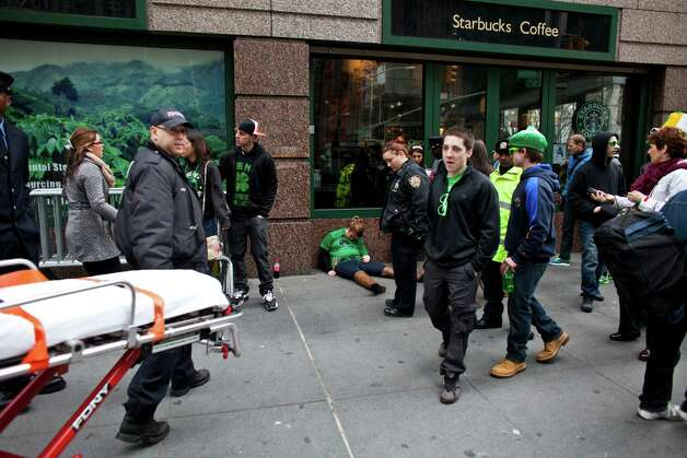 An emergency crew responds to a woman during the 252nd annual St. Patrick's Day Parade March 16, 2013 in New York City. The parade honors the patron saint of Ireland and was held for the first time in New York on March 17, 1762, 14 years before the signing of the Declaration of Independence. Photo: Ramin Talaie, Getty Images / 2013 Getty Images