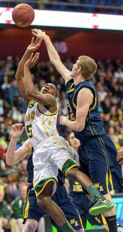 Trinity Catholic High School's Brandon Wheeler and Woodstock Academy's John McGinn fight for a rebound in the CIAC class L boys basketball championship game at Mohegan Sun Arena in Uncasville, Conn. on Saturday, March 16, 2013. Photo: Mark Conrad / Connecticut Post Freelance