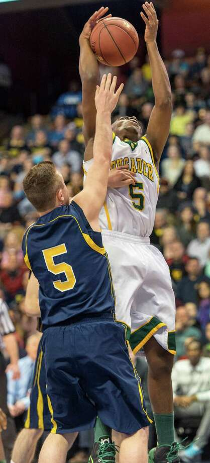Trinity Catholic High School's Brandon Wheeler pulls down a rebound during the CIAC class L boys basketball championship game against Woodstock Academy at Mohegan Sun Arena in Uncasville, Conn. on Saturday, March 16, 2013. Photo: Mark Conrad / Connecticut Post Freelance