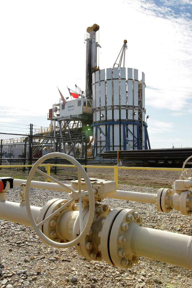 Oklahoma City-based Chesapeake, which has this production facility in Fort Worth, is dealing with low natural gas prices and heavy debt. Natural gas still makes up  76 percent of its total output, down from 81 percent a year ago. Photo: RON T. ENNIS, MBR / Fort Worth Star-Telegram