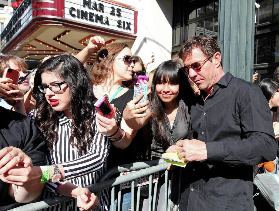 "Actor Dennis Quaid (right) signs autographs for fans outside the Paramount Theatre before a showing of Ramin Bahrani's film ""At Any Price"" during South by Southwest Saturday March 16, 2013 in Austin, TX. Photo: Edward A. Ornelas, Edward A. Ornelas / San Antonio Express-News / © 2013 San Antonio Express-News"