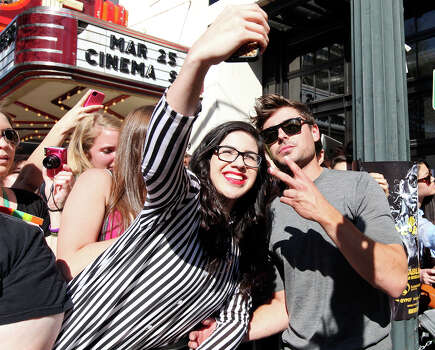 "Steffi Ramos (left) poses for a photo with actor Zac Efron outside the Paramount Theatre before a showing of Ramin Bahrani's film ""At Any Price"" during South by Southwest Saturday March 16, 2013 in Austin, TX. Photo: Edward A. Ornelas, Edward A. Ornelas / San Antonio Express-News / © 2013 San Antonio Express-News"