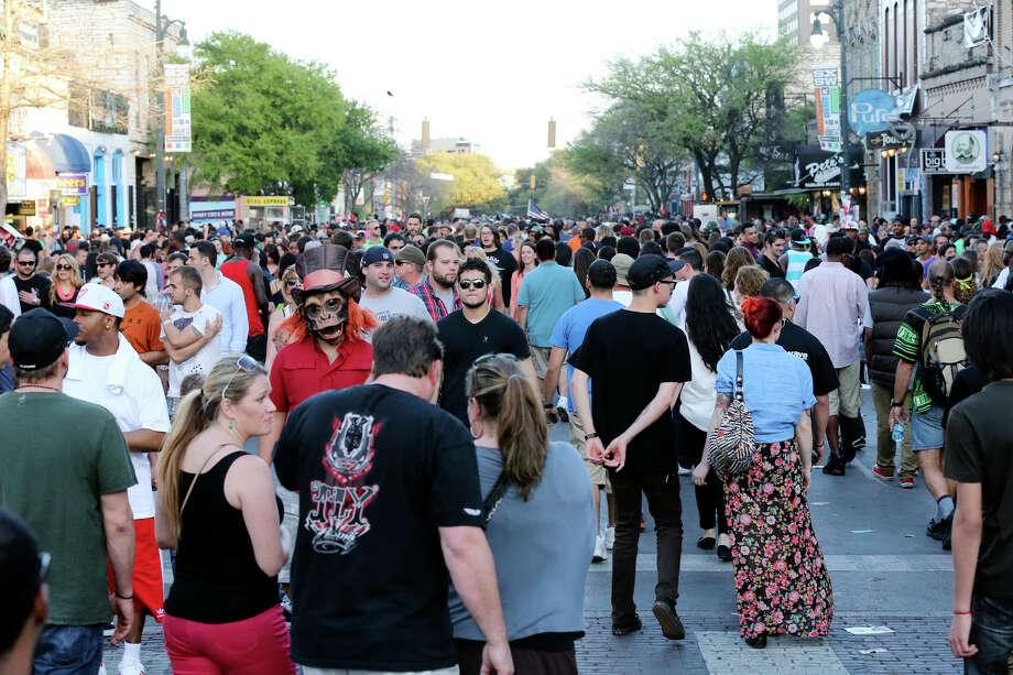 Crowds meander on 6th Street during South by Southwest Saturday March 16, 2013 in Austin, TX. Photo: Edward A. Ornelas, Edward A. Ornelas / San Antonio Express-News / © 2013 San Antonio Express-News