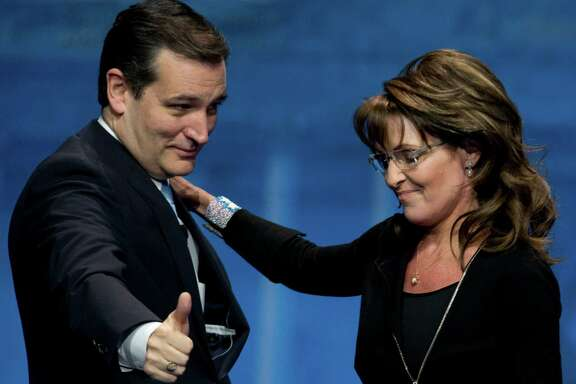 Sen. Ted Cruz greets former Alaska Gov. Sarah Palin after introducing her at the 40th annual Conservative Political Action Conference on Saturday. Cruz later spoke, urging fidelity to consrvative ideals.