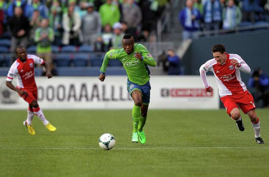 Steve Zakuani, center, navigates downfield to score the only goal of the first half against the Port