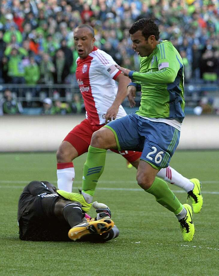Sounders forward Samuel Ochoa, right, steps on Portland Timbers goalkeeper Donovan Ricketts, bottom, during the first half of a game Saturday, March 16, 2013, at CenturyLink Field in Seattle. Ricketts remained in the game. Photo: JORDAN STEAD / SEATTLEPI.COM